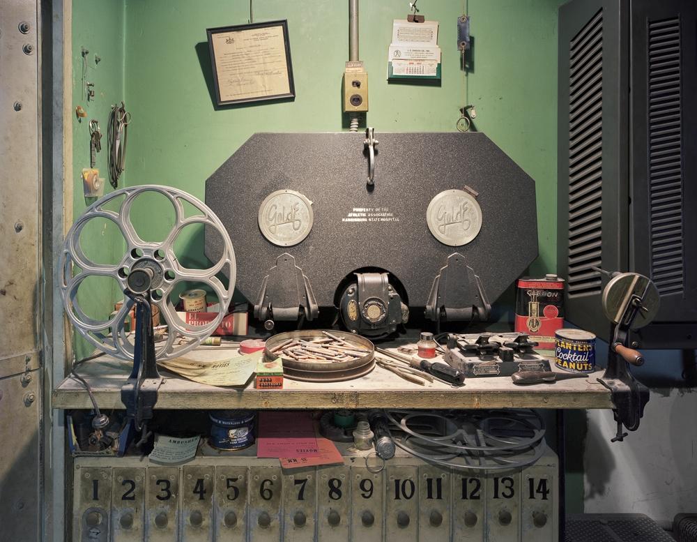 "Christopher Payne<br /> <em>Film Projection Equipment, Harrisburg State Hospital, Harrisburg, PA</em>, 2005<br /> Digital chromogenic print<br /> 20 x 24""  Edition of 10<br /> 40 x 50""  Edition of 8<br /> 50 x 60""  Edition of 5"