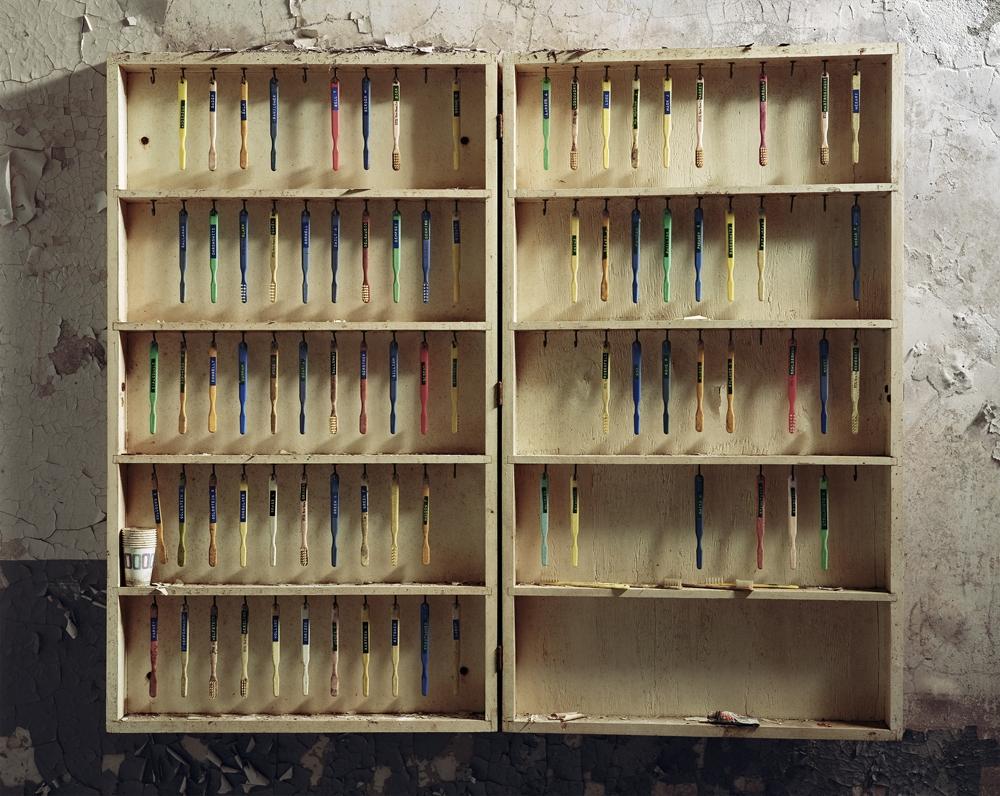 "Christopher Payne<br /> <em>Patient Toothbrushes, Hudson River State Hospital, Poughkeepsie, NY</em>, 2005<br /> Digital chromogenic print<br /> 20 x 24""  Edition of 10<br /> 40 x 50""  Edition of 8<br /> 50 x 60""  Edition of 5"